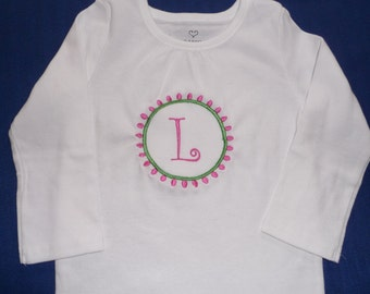 Shirt embroidered with preppy circle and monogrammed with initial.