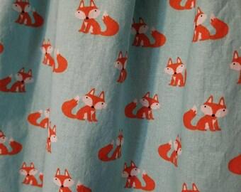 Blue sky foxy box pleated skirt.