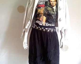 Vintage skirt 80s, black color, polyester, lined, us size 14, excellent condition.