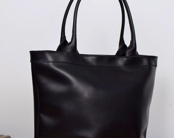 Black Leather tote bag with zipper and inside lining. Handmade.