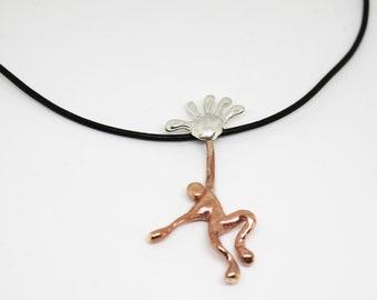 U-Mano: bronze and silver pendant
