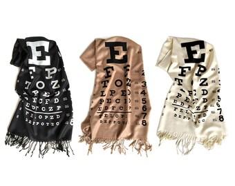 Eye Chart scarf. Linen weave pashmina, silkscreen print. Black, cream, sandy beige scarf. Optometrist gift, optician, eye doctor gift.