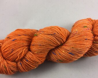 hand dyed sock yarn, donegal tweed, superwash merino wool and NEP (tweed bits), colorway PERSIMMON