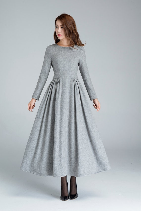 This modern, long-sleeve ballgown from Essense of Australia is the perfect gown for the modern-day bride. Artfully-placed lace accentuates the bodice of this style, creating a high neckline - with cutouts - that extends down into long, lace sleeves.