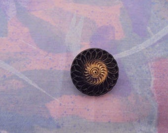 Vintage black and 22 mm copper button