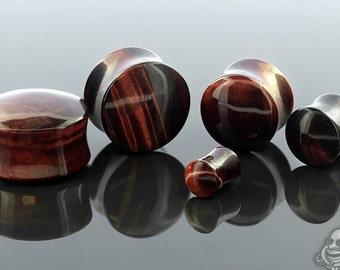 "DF Red Tiger's Eye stone plugs 6g, 4g, 2g, 0g, 00g (9.5mm), 7/16"", 1/2"" (13mm), 9/16"", 5/8"", 3/4"", 7/8"", and 1"""