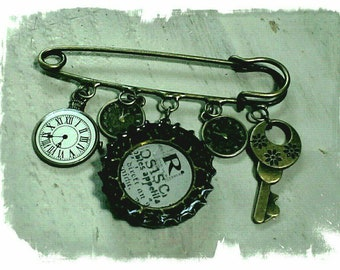 Steampunk recycled bottle top kilt pin.