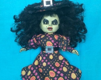 Arnica Dorcha is a OOAK witch art doll