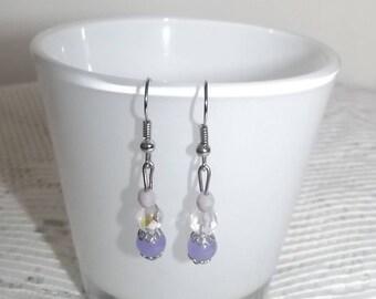 Purple stud earrings.