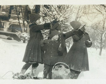 Vintage photo Children on Sled Point toward Sky