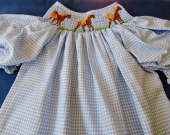 Hand smocked dress with horses
