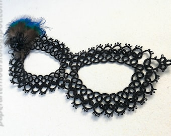 Black tatted carnival mask