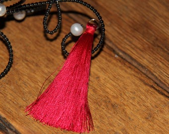 The large tassel red tassel with silver plated ring