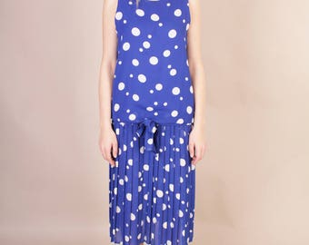 Vintage 80s blue indygo dress with white dots // dropped waist retro dress  with a bow and pleated bottom