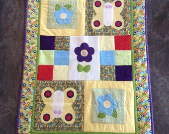 Girl crib blanket with appliqués and matching blankie