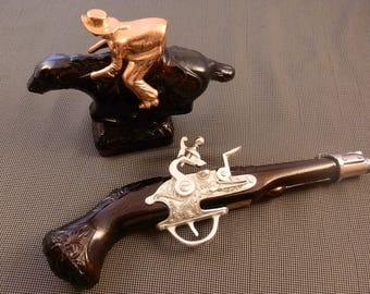 Avon Cowboy & Avon flintlock aftershave bottles