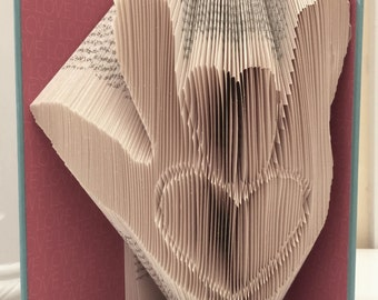 Folded book art: I love you (sign language)