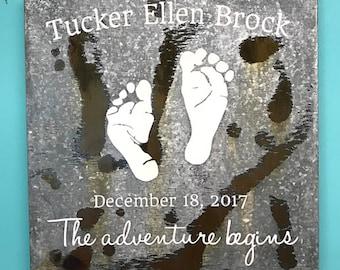 Baby footprints on rusted metal