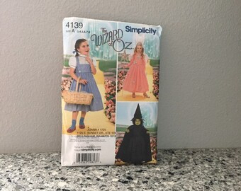Wizard of Oz Halloween or Party costume pattern for girls Simplicity 4139 Size A 3-8 Dorothy dress, good witch, and wicked witch UNCUT