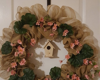 Spring cherry blossoms on burlap wreath with birdhouse