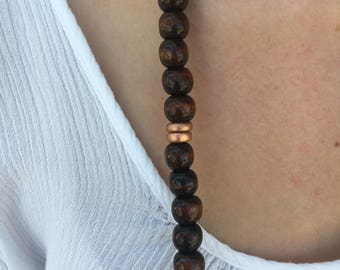 Dark wood beaded necklace with rose gold details