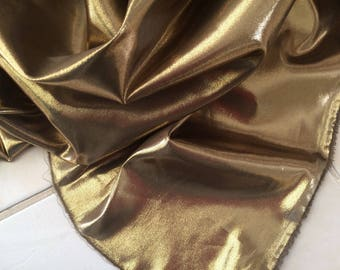 Fabrics in festive gold satin color metallic very soft and sheer fliuide
