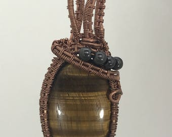 Tigers Eye oval pendant with Hematite