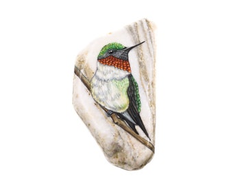 Hand-painted rock marble pebble with a humming bird