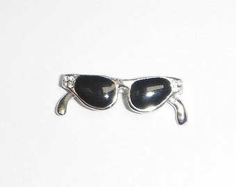Silver tone and black 3D glasses