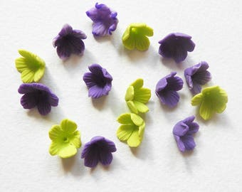 a set of 15 small flowers of polymer clay
