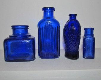 Vintage small cobalt blue ink well and medicine bottles