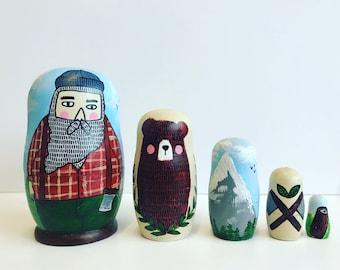 Russian matryoshka dolls, painted nesting dolls, Lumberjack theme dolls