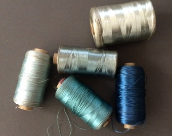 5 x vintage rayon floss reels of hand embroidery thread.