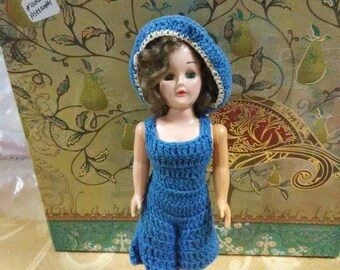 Vintage Madam Alexander doll with brown hair and blue eyes. Blue dress. White heels.