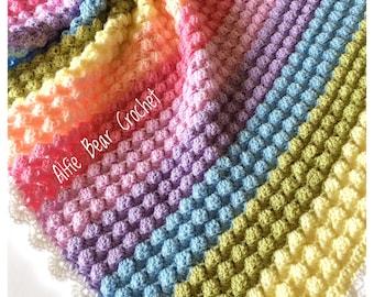 Handmade crochet baby blanket in pinks, lemon, blue, green and purple