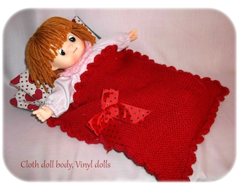 Vinyl baby girl doll, cloth body soft sculptured, sleeper. Comes to you dressed with a handmade nightdress. The doll is high 34 CM.