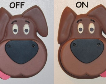 Dog light switch cover with switchable tongue