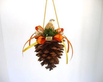 Ornament, pine cone ornament, decorated pine cone with ceramic sparrow