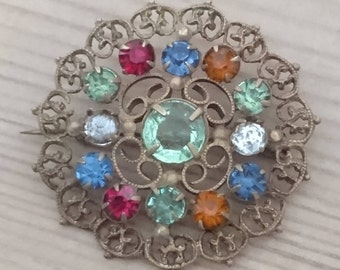 Vintage sparkly rhinestone filigree brooch