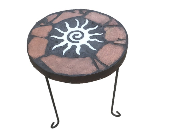 "Sunburst: A 14 1/"" diameter x 18 1/2"" tall natural stone topped folk art table with a Hopi sun symbol focus"