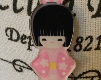 Pink waxcord necklace with a pink japanese girl, pendant