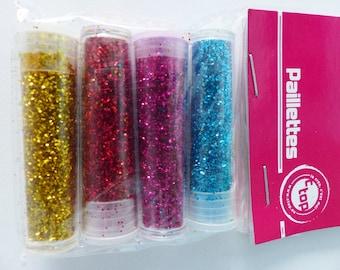 4 tubes of glitter blue pink yellow gold glitter
