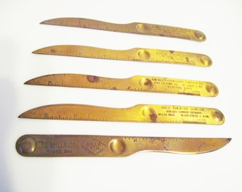 Five 8 inch brass colored Letter opener rulers with advertising and ruler marking for 6 inches