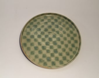 Green and cream checked plate thrown on the wheel in stoneware clay