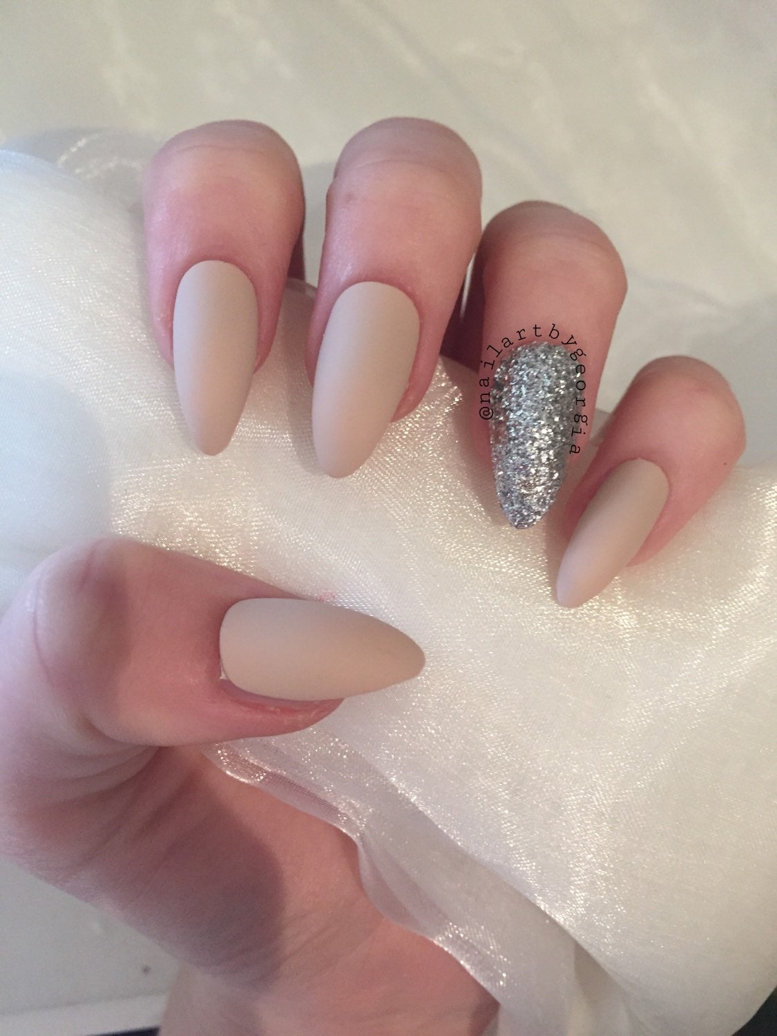 Matte nude almond false nails with silver glitter from ...