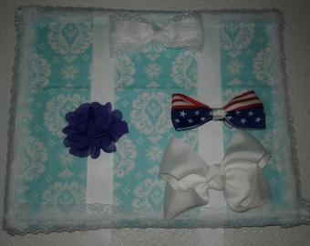 light blue damask bow holder