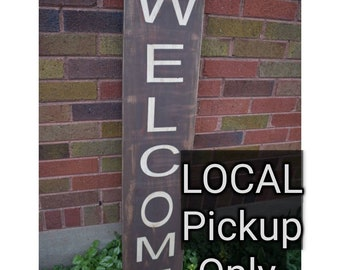 Welcome Sign LOCAL residents pick up listing