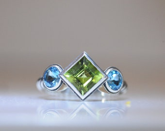 Sterling silver peridot and blue topaz ring.