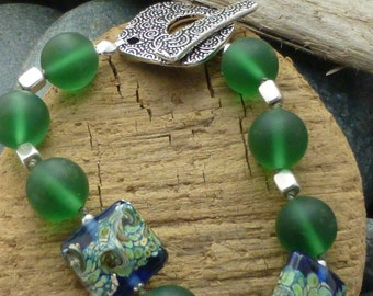 Frosted green glass with lamp work beads bracelet