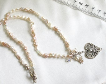 Handmade fresh water pearl necklace with a fine silver heart